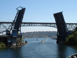 Fremont Avenue bascule bridge opening with George Washington Bridge, commonly called the Aurora Bridge, seen in the background. Photo