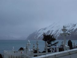 Crosses at the Russian Orthodox Cemetery at Dutch Harbor on a gray and wintery day. Photo
