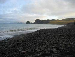 A boulder beach on the coast of St Photo