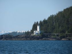 Cape Decision Lighthouse seen from offshore. Photo