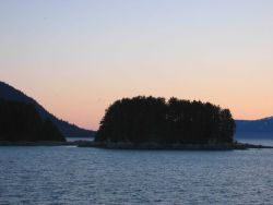 A small islet or perhaps just an extension of the mainland connected by a small isthmus. Photo