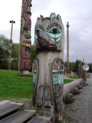 An old decrepit totem pole. Photo