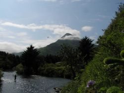 Idyllic view of fisherman in Kodiak stream with Barometer Mountain in the background. Photo