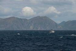 A fishing boat on a brisk day off the Alaska Peninsula. Photo