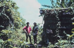 Local guides standing next to basalt buildings of prehistoric Nan Madol. Photo