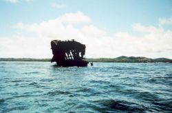 A rusted out World War II vessel Photo