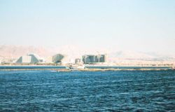 Sea bream aquaculture facility offshore from resort hotels at Eliat, Israel. Photo
