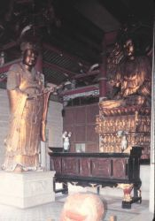 Buddhist temple with decorative metal sculpture Photo