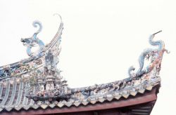 Ornate dragons adorn a temple roof. Photo