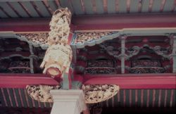 Ornate decorations on a Buddhist Temple. Photo