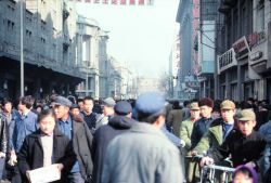 Masses of humanity fill a Chinese city street. Photo