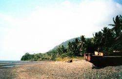 A derelict boat on the beach at the prison island of Isla Gorgona. Image