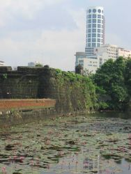 A view of a modern building from the inner fort of the Intramuros of Manila. Image
