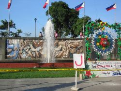 A celebratory float for a parade to be held at Rizal Park with a mural in the background. Image