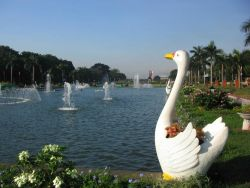 Fountains and a whimsical sculpture at Rizal Park. Photo