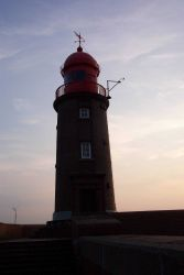 The lighthouse at the end of the seawall at Bremerhaven. Photo