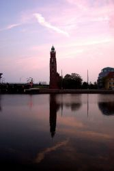 The Bremerhaven Lighthouse reflected in the water. Photo