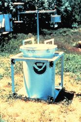During the early 1980s, NSSL and University of Oklahoma researchers place TOTO (TOtable Tornado Observatory) in the path of an on-coming tornado Photo