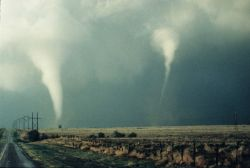 A rare photograph of two tornadoes over the Great Plains. Image