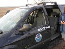 The tornadic storm observed earlier was accompanied by large dangerous hail which smashed the windshield of this National Severe Storms Laboratory ins Photo