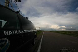 Mobile Mesonet vehicle stopped alongside the road with storm ahead. Photo