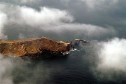Anacapa Island and lighthouse through the clouds. Image