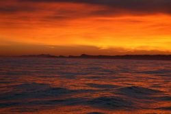 A magnificent sunrise looking east from San Miguel Island. Image