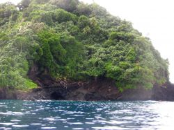 A sea cave or lava tube on the volcanic shores of American Samoa. Image