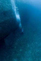 Diver below stern and upside-down rudder of the NORTHERN LIGHT, a shipwreck in 190 feet water depth Photo