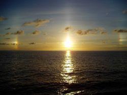 A tropical sunset over a placid sea. Photo