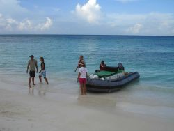Coming ashore with supplies for a shore camp. Photo