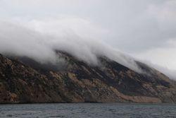 Fog streaming over Santa Cruz Island following stream valleys towards the sea. Photo