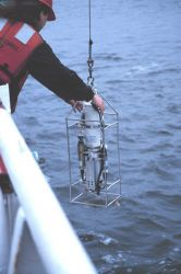 Deploying a CTD instrument from the NOAA Ship FERREL. Photo