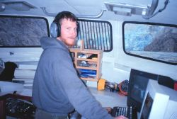 Assistant Survey Tech Scot Warrender operating the computers aboard RA-1 Photo