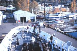 Chief Boatswain Jim Kruger (in green hard hat) directs RAINIER Deck Department personnel as the RAINIER returns home to Seattle and its base at the Pa Photo