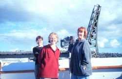 Happy crew members as the RAINIER approaches Lake Union ship base at the end of a long surveying season. Photo
