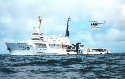 NOAA Ship DAVID STARR JORDAN and MD500 helicopter during marine mammal studies in the tropical east Pacific Ocean. Photo