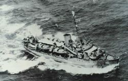 The Coast and Geodetic Survey Ship PATHFINDER enroute to Okinawa where it sustained a kamikaze hit but survived to enter Tokyo Bay at the end of hosti Photo