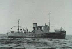 The Coast and Geodetic Survey Ship WAINWRIGHT conducting wire drag operations. Photo