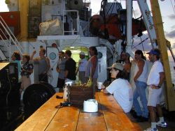 Shipboard and scientific crew unite for the 2nd Annual Thanksgiving Pinata Festival on board the NOAA Ship McARTHUR during Project STAR 2000. Photo