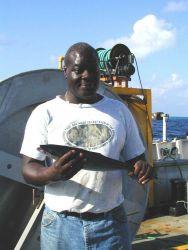 Seaman surveyor Leroy Johnson holding rainbow runner caught off Clipperton Island Photo