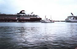 The McARTHUR dwarfed by cruise ships as it enters Key West Harbor. Photo