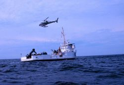 NOAA Ship FERREL working off Savannah with helicopter support. Photo