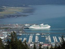 NOAA Ship Rainier dwarfed by cruise ship; from atop Mt Photo