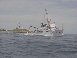 NOAA Ship RUDE off Montauk Lighthouse. Photo