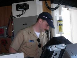 Ensign Salisbury on watch checking the radar. Photo