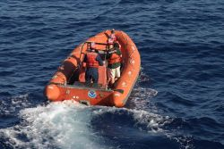Departing ship on rigid-hulled-inflatable-boat (RHIB) off NOAA Ship THOMAS JEFFERSON. Photo
