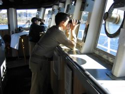 Captain Emily Christman and officer of the deck looking ahead to on-coming traffic. Photo