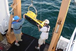 An EdgeTech SB 0512 combination sidescan sonar and bottom penetration sonar towfish being deployed from the DELAWARE II during habitat mapping operati Photo