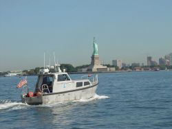 Survey launch off the NOAA Ship THOMAS JEFFERSON conducting hydrographic survey in New York Harbor near the Statue of Liberty. Photo